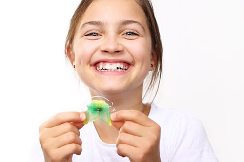 Girl-Holding-her-Retainers